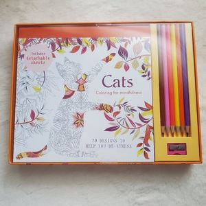 Adult Colouring Book with coloured pencils.